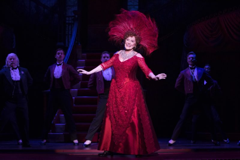 "Betty Buckley as Dolly, dressed in a stunning red dress, performs the show-stopping number ""Hello, Dolly."""